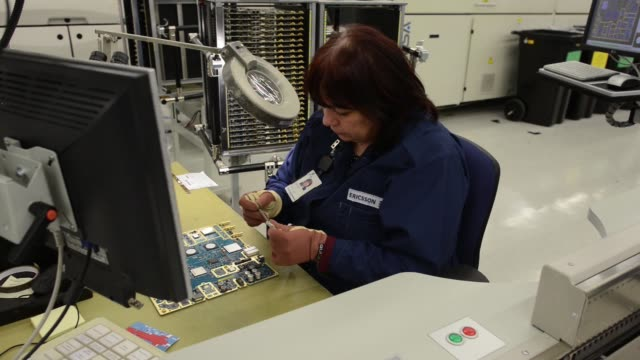 ericsson ab employees work on 2g 3g and 4g data networking devices during production at the company's factory in tallinn estonia on wednesday april... - 3g stock videos & royalty-free footage