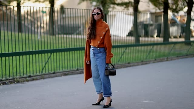 erika boldrin wearing orange knit with long sleeves denim jeans is seen outside koche during paris fashion week womenswear spring/summer 2019 on... - fashion week stock videos & royalty-free footage