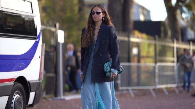 erika boldrin wears a black blazer jacket, a blue dress, a blue bag, outside hermes, during paris fashion week womenswear spring/summer 2019, on... - jacket stock videos & royalty-free footage