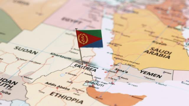 vídeos de stock e filmes b-roll de eritrea with national flag - etiópia ouro