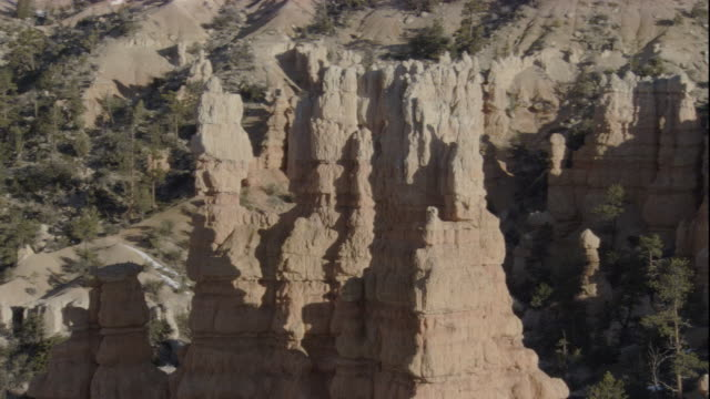 eroded limestone pinnacles tower in bryce canyon, utah. available in hd. - eroded stock videos & royalty-free footage