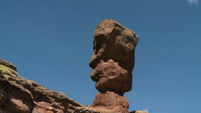 eroded rock at the base of a hill, andes, peru - weathered stock videos & royalty-free footage
