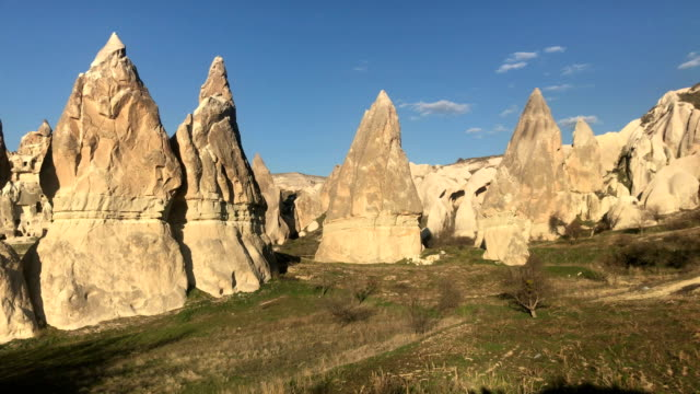 eroded rock formations in cappadocia - pinnacle stock videos & royalty-free footage