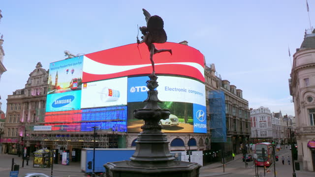 eros statue in piccadilly circus, london - advertisement stock videos & royalty-free footage