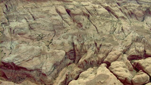erosion channels scar a sandstone formation. - sandstone stock videos & royalty-free footage