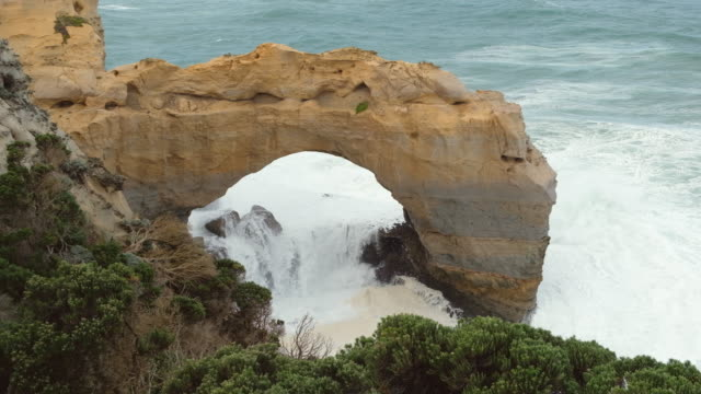 erosion rock in ocean, australia - port campbell national park stock videos & royalty-free footage