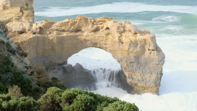 erosion rock in ocean, australia - great ocean road stock videos & royalty-free footage