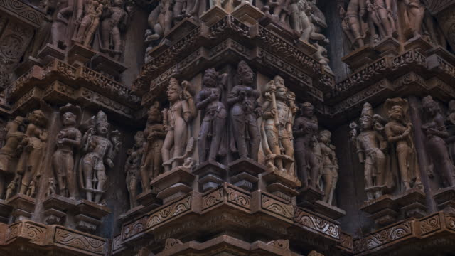 erotic sculptures at the parshvanatha temple, within the khajuraho group of monuments in the chhatarpur district, madhya pradesh, india, asia - 美術工芸品点の映像素材/bロール