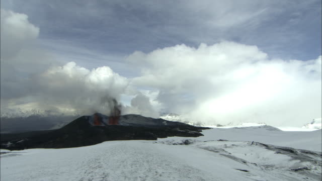 ws erupting volcano, sprays of lava, snow, eyjafjallajokull, iceland, april 2010 - 2010 stock videos and b-roll footage