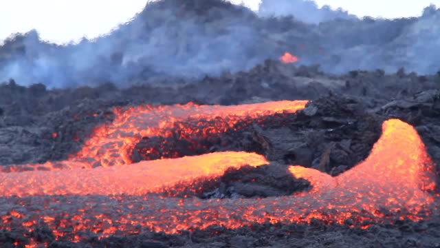 eruption of volcano lava flow - volcano stock videos & royalty-free footage