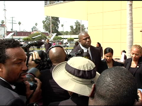 ervin 'magic' johnson at the funeral of johnnie l cochran, jr arrivals at west angeles cathedral in los angeles, california on april 6, 2005. - johnnie cochran stock videos & royalty-free footage