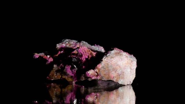 erythrin mineral turning on black - quartz stock videos & royalty-free footage