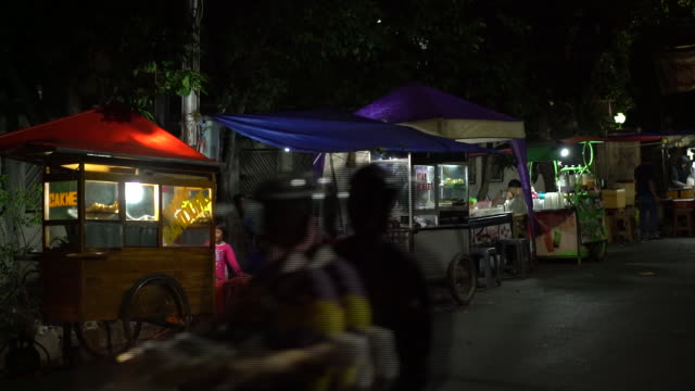 es kepalÿmiloÿviral street stall in the tebet area of jakarta indonesia on friday july 13 2018 - personal land vehicle stock videos & royalty-free footage