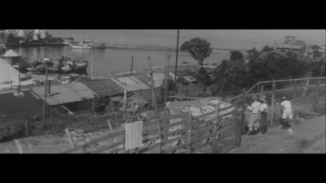 vidéos et rushes de escalating chisso battles/first union picket outside new japan chisso minamata factory gate, first union observation post, observation ship,... - philadelphie