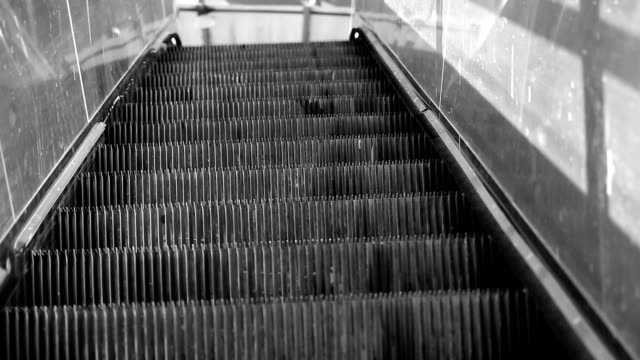 escalator climbing up - stair lift stock videos and b-roll footage