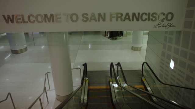 ms pov escalator entering sfo terminal - san francisco international airport stock videos & royalty-free footage