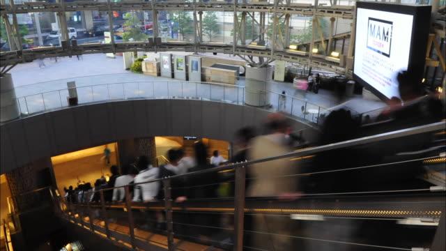 t/l ms ha escalator in modern building, roppongi hills, tokyo, japan - roppongi hills stock videos and b-roll footage