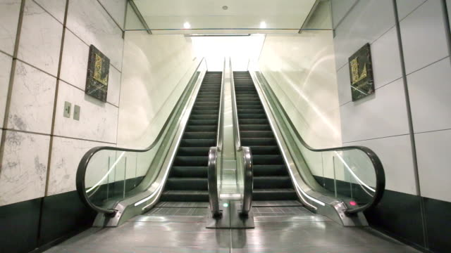 escalator in modern hall - escalator stock videos & royalty-free footage
