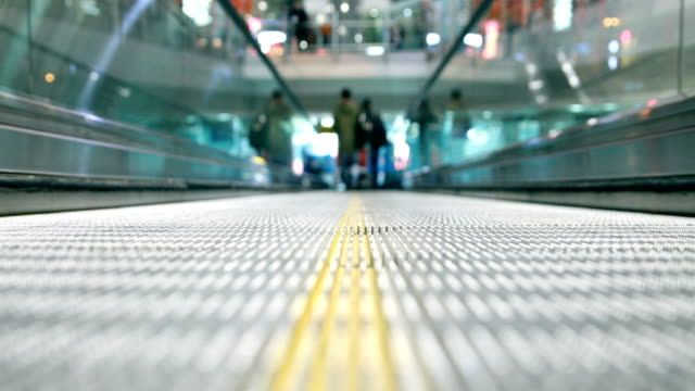 escalator in the airport - building entrance stock videos and b-roll footage