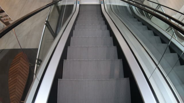 escalator moving staircase - stair lift stock videos and b-roll footage