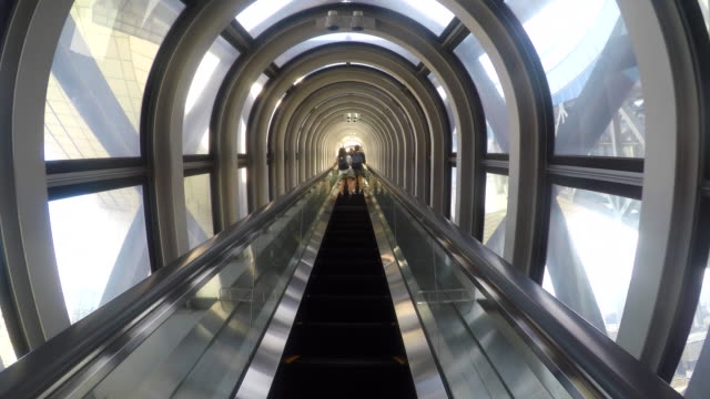 Escalator moving up in Modern Building