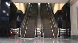 Escalator without any people on it going down in Slow Motion.