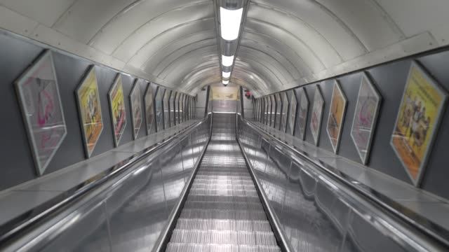march 25: escalators on the london underground during a hour rush period during the coronavirus pandemic. british prime minister, boris johnson,... - tube stock videos & royalty-free footage