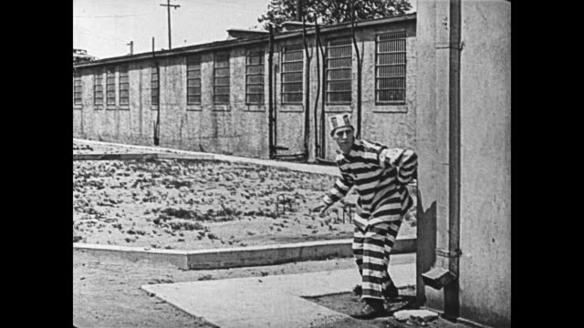 1920 escaped convict changes clothes with unconscious man (buster keaton) - prison escape stock videos and b-roll footage