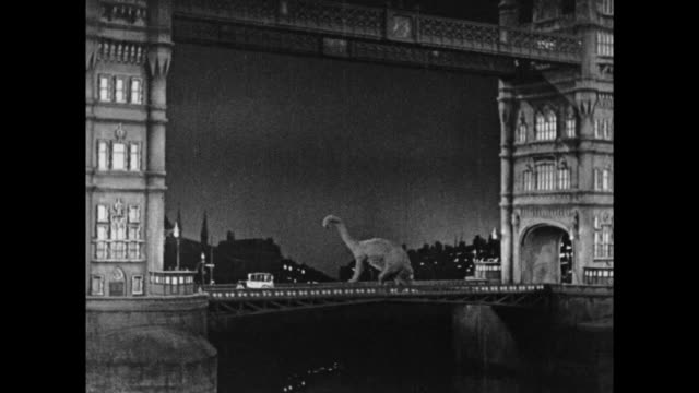1925 escaped dinosaur tries to cross london bridge but falls into the thames river - london bridge england stock videos & royalty-free footage