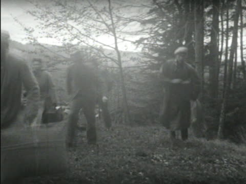 escapees carrying suitcases walking through a mountain field, reaching a swiss refugee hostel, where they are greeted and fed and allowed temporary... - escaping stock videos & royalty-free footage