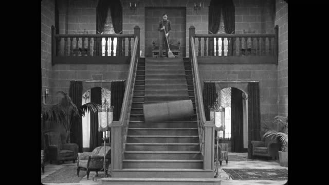 1922 escaping man (buster keaton) is thwarted by rug and rolls to a stop in front of pursuers - rug stock videos & royalty-free footage