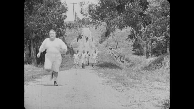 1918 escaping man (fatty arbuckle) joins track meet - slapstick stock videos & royalty-free footage