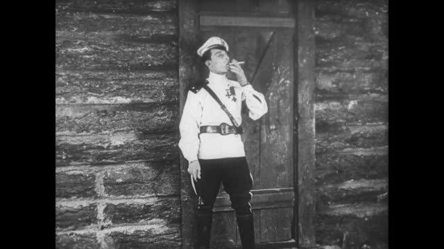 1922 escaping man (buster keaton) returns for woman, morphing into sea captain before her panicked eyes - imagination stock videos & royalty-free footage