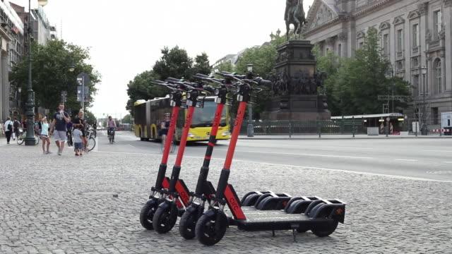 escooters and traffic in berlin germany on thursday july 18 2019 - motorroller stock-videos und b-roll-filmmaterial