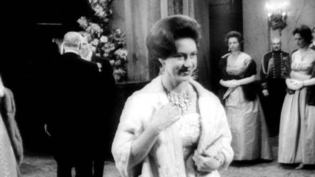 stockvideo's en b-roll-footage met escorted by the queen mother princess margaret and her fiance antony armstrongjones make their first public appearance since their surprise... - prinses margaret windsor gravin van snowdon