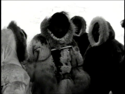 ms eskimo man gesturing to companions - inuit stock videos and b-roll footage