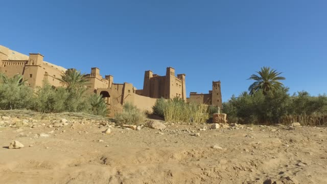 esploring ait-ben-haddou casbah (kasbah) - movie set of games of thrones - pjphoto69 stock videos & royalty-free footage