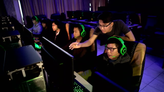 eSports coach with gamer team planning game strategy