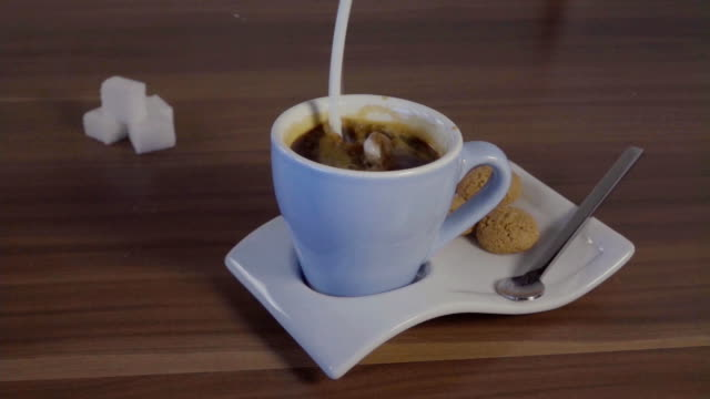 espresso coffee cover slow motion - coffee table stock videos & royalty-free footage