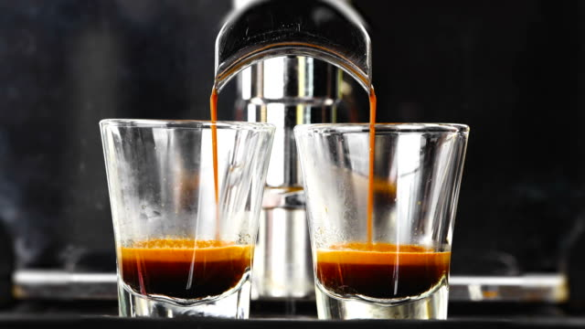 espresso coffee from machine close up. - espresso stock videos & royalty-free footage