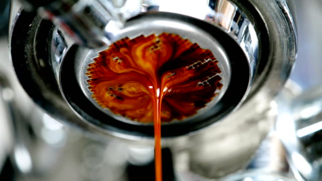 espresso coffee from machine close up. - machinery stock videos & royalty-free footage