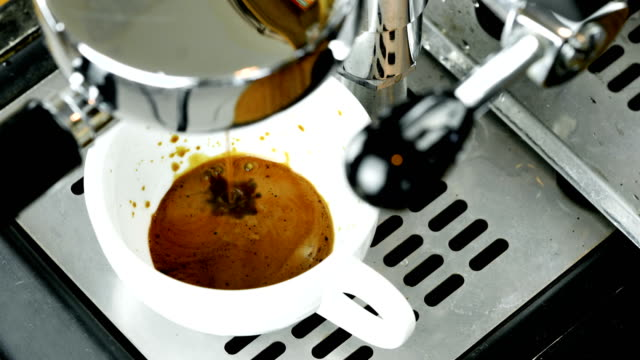 espresso coffee from machine close up. - espresso maker stock videos and b-roll footage