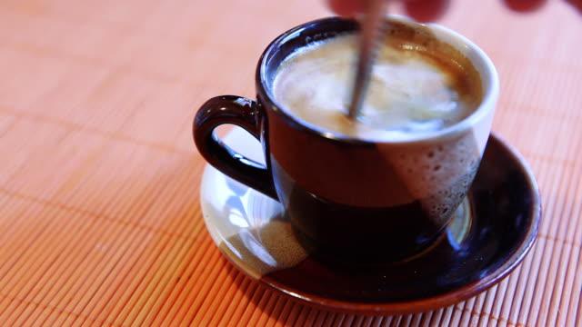 HD: Espresso coffee with spoon