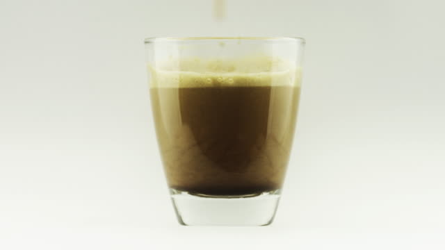 espresso dripping in a coffee cup - espresso maker stock videos and b-roll footage