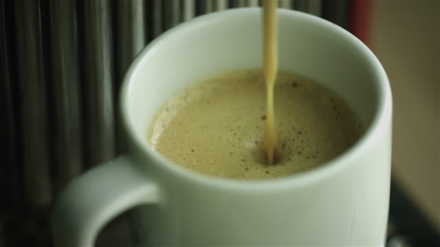 espresso dripping in a coffee cup - selective focus stock videos & royalty-free footage