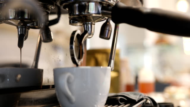 espresso machine filling cup of coffee in cafe - espresso maker stock videos and b-roll footage