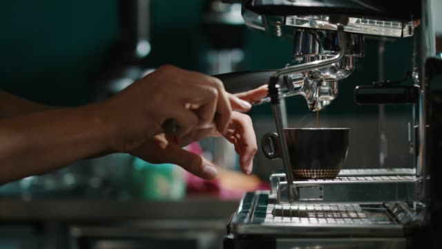 espresso maker pouring coffee - espresso maker stock videos and b-roll footage