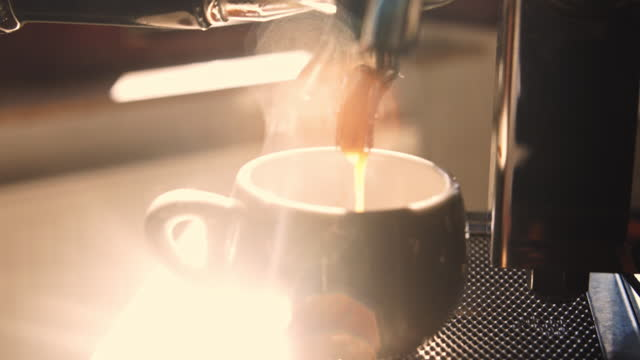 espresso shot pouring out of espresso maker. - coffee cup stock videos & royalty-free footage