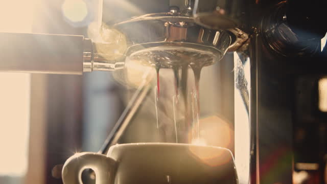 espresso shot pouring out of espresso maker. - 50 seconds or greater stock videos & royalty-free footage
