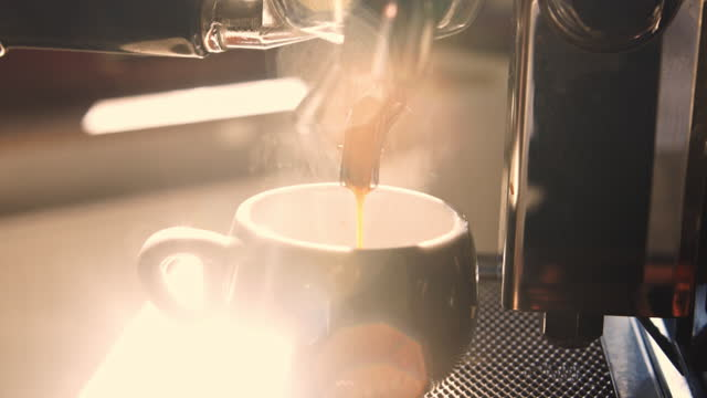 espresso shot pouring out. - coffee cup stock videos & royalty-free footage